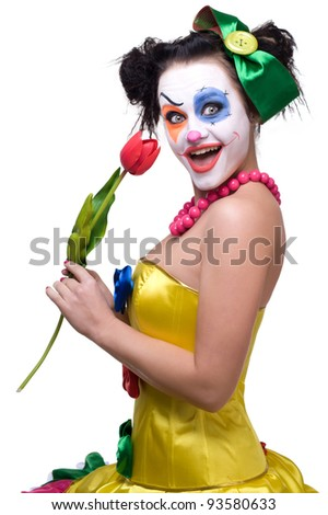 Proud Clown Displaying a Flower - stock photo