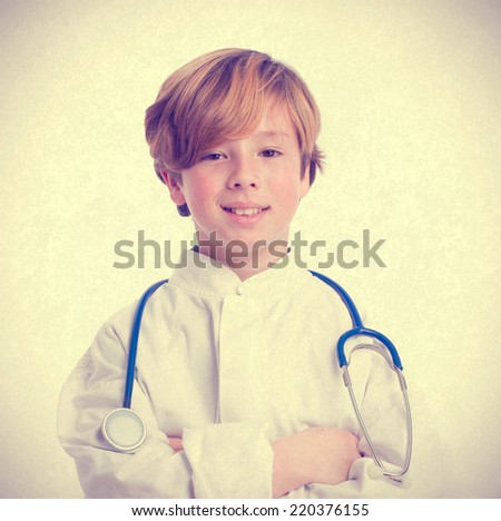 Proud doctor boy with a stethoscope - stock photo