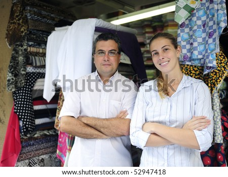 proud family business partners owners of a fabric store - stock photo