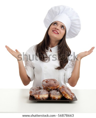 proud female chef in white uniform and hat with doughnuts ( donuts ) - stock photo