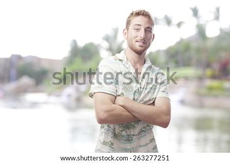 proud ginger young man with hawaiian shirt - stock photo