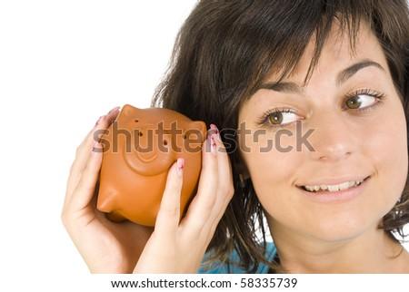 Proud girl holding piggy bank full of savings - stock photo