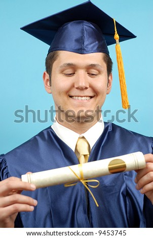 Proud graduate looking at his new degree - stock photo