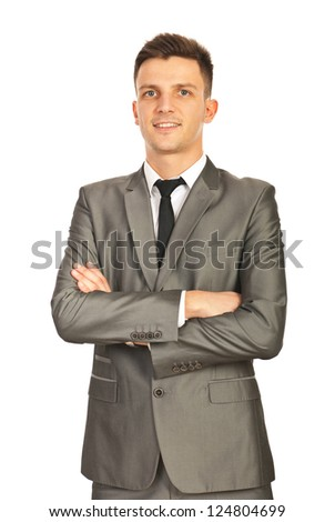 Proud happy business man standing with arms folded isolated on white background