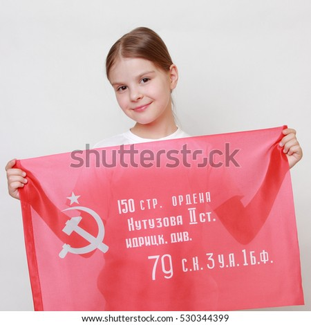 Proud little girl holding Victory Banner - Assault flag of the 150th Order of Kutuzov II Degree Idritsa Infantry Division in the second World War