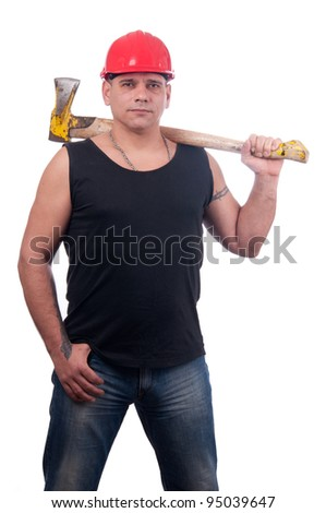 Proud lumberjack posing with red helmet on his head and big old ax on his shoulder - stock photo