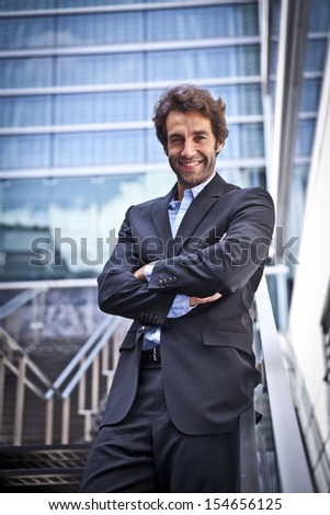 Proud Man In Front Of His New Office - stock photo