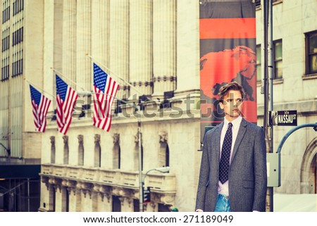 Proud Man. Young blonde, handsome businessman, wearing blazer, necktie, standing by vintage style office building with American flags, confidently looking forward. Instagram filtered effect.  - stock photo