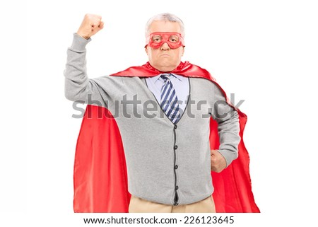 Proud mature man in superhero costume throwing his fist in the air isolated on white background - stock photo