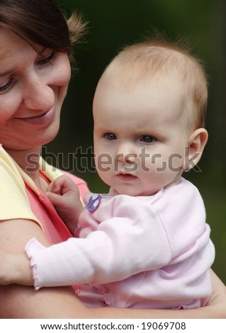 Proud mom hold her cute baby - stock photo