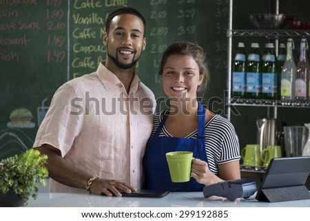 Proud owners of a cafe - stock photo