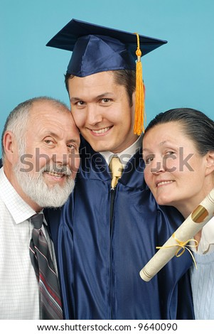 Proud parents with their son on graduation day - stock photo