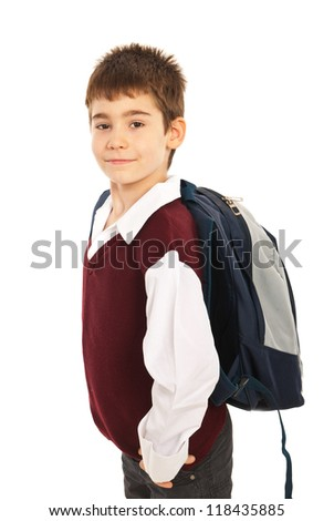 Proud schoolboy with back bag standing in profile isolated on white background