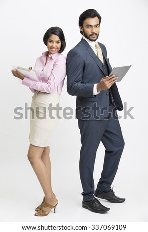 Proud smiling businessman standing with his colleague on white background. - stock photo