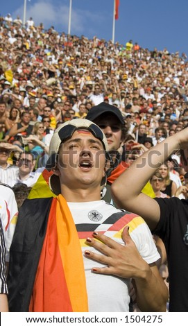 proud soccer fan at world cup in germany - stock photo