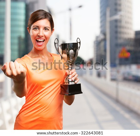 proud sport woman with sport cup
