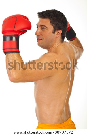 Proud victorious boxer man raising arms isolated on white background - stock photo