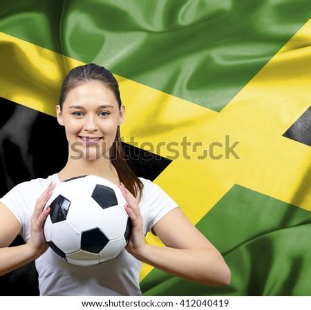 Proud woman football fan of Jamaica - stock photo
