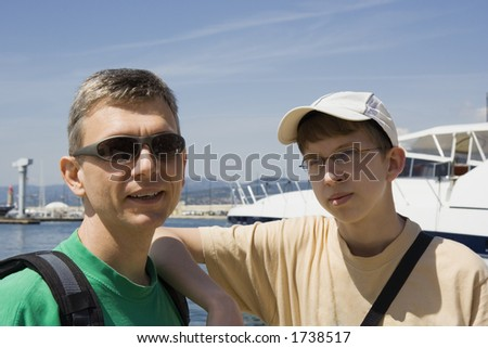 proud yacht owners - focus is on the man - saint-tropez, french riviera, mediterranean sea - stock photo