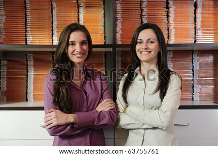 proud young business partners, owners of a video rental store - stock photo