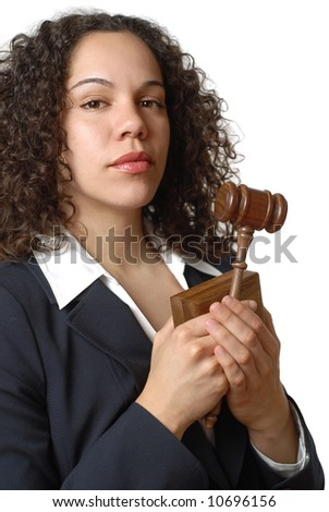 Proud young woman of the legal profession holding a judge's gavel - stock photo