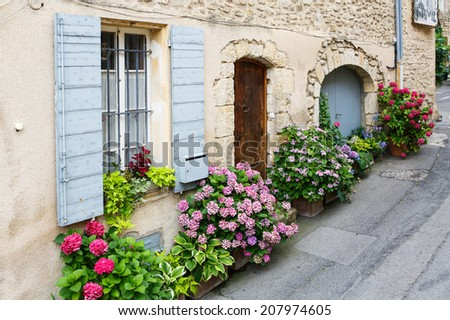 Provencal street with typical houses in southern France, Provence