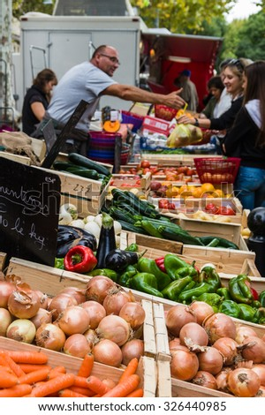 Provence, France - September 2015 - Selling vegetable on market place in Provence, France. 2015
