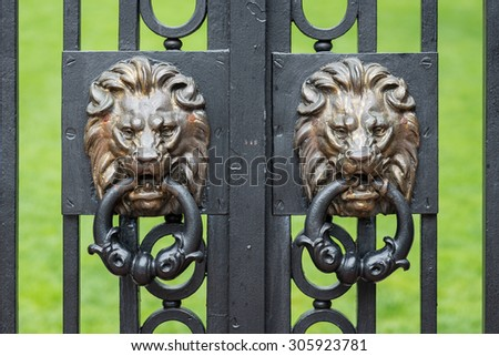 PROVIDENCE, RHODE ISLAND - JULY 24: Lions on the Van Wickle gates (1901) on the campus of Brown University on July 24, 2015 in Providence, Rhode Island - stock photo