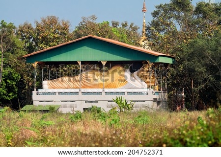 PROVINCE CHIANG MAI, THAILAND - FEBRUARY 11: Sculpture of reclining Buddha under a canopy in temple Nantharam in province Chiang Mai, Thailand, February 11, 2014 - stock photo