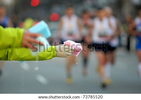 Provisioning sponges for competitors on a long distance race - stock photo