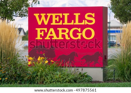 PROVO, UT/USA - OCTOBER 2, 2016: Wells Fargo exterior sign and logo. Wells Fargo & Company is an American international banking and financial services holding company.