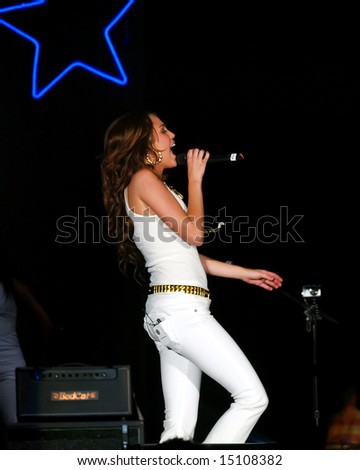 PROVO, UTAH - JULY 4: Miley Cyrus performs at the Stadium of Fire on July 4, 2008 in Provo, Utah. - stock photo