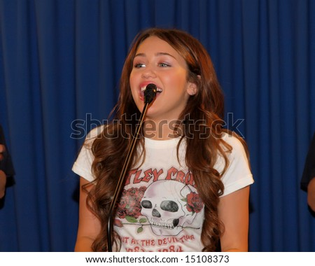 PROVO, UTAH - JULY 4: Miley Cyrus speaks to media before performing at the Stadium of Fire on July 4, 2008 in Provo, Utah. - stock photo