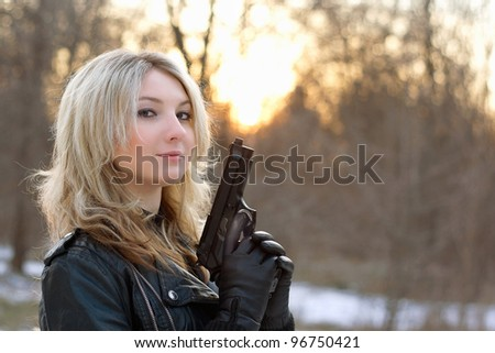 Provocative young woman at sunset in winter forest - stock photo