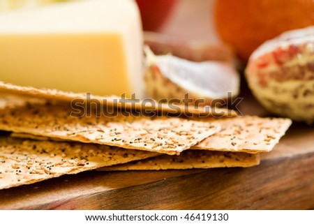 Provolone and flatbread crackers with sesame, caraway and poppy seeds ...