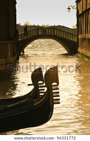 Prows of two gondolas moored on Rio dei Giardinetti canal - Venice, Venezia, Italy, Europe - stock photo