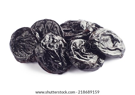 Prunes on white background closeup - stock photo