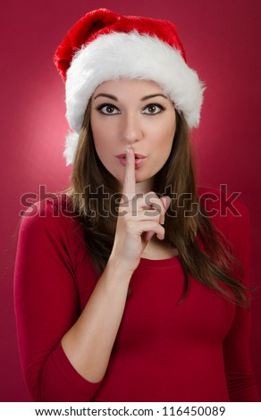 Psst - woman with red santa hat - stock photo