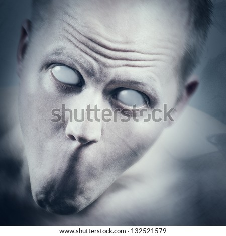 Psychedelic and scary man with white eyes and no mouth. - stock photo