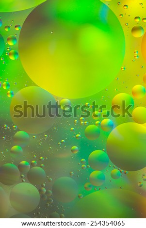 Psychedelic yellow and green oil and water abstract, unfocused - stock photo