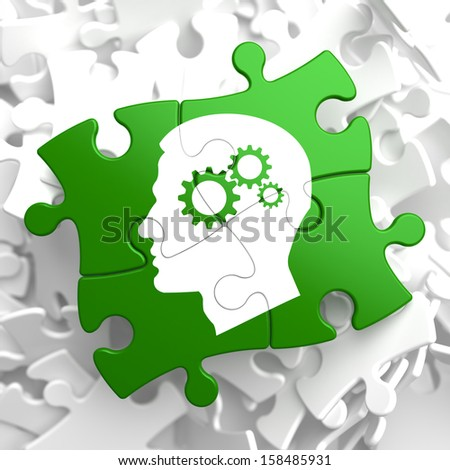 Psychological Concept - Profile of Head with Cogwheel Gear Mechanism Located on Green Puzzle Pieces. - stock photo