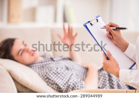 Psychologist having session with her patient in her private consulting room. - stock photo