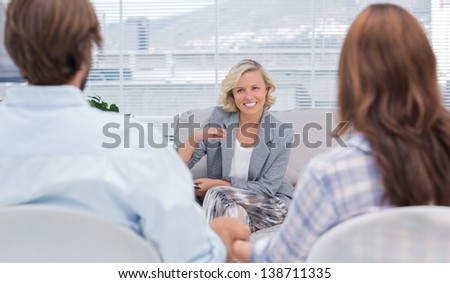 Psychologist speaking to a couple during a session - stock photo