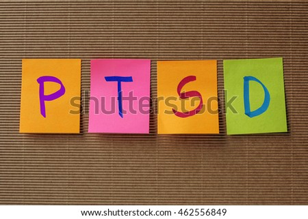 PTSD (Posttraumatic stress disorder) acronym on colorful sticky notes
