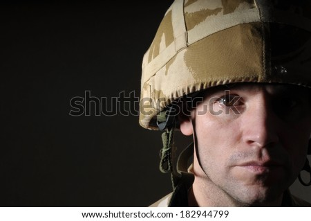 PTSD Soldier With Half Face In Shadow - stock photo