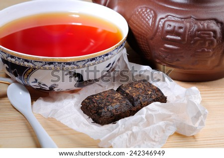 pu erch black tea - stock photo