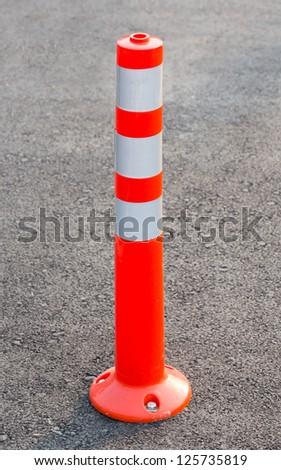 PU lane divider on asphalt road - stock photo