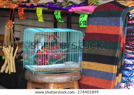 PUARTO VALLARTA , MEXICO - JULY 7, 2007: Souvenir stands along city streets.  Approximately 2 million tourists  visits Vallarta and her surroundings. Tourism is a major income for the locals.  - stock photo