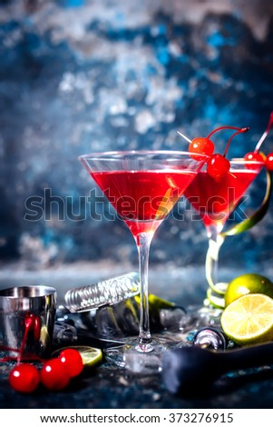 pub details - alcoholic cocktail with vodka and gin, cosmopolitan long drink in premium glass - stock photo