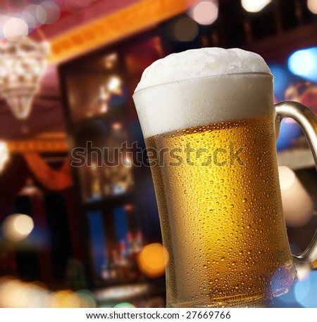 pub interior view through window with reflection of street lights - stock photo